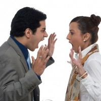 A young Indian man and woman arguing.