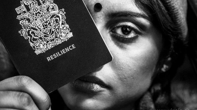 Diaspora. Black and White photo of a South Asian Woman holding a passport covering her face. The passport says Resilience on it.